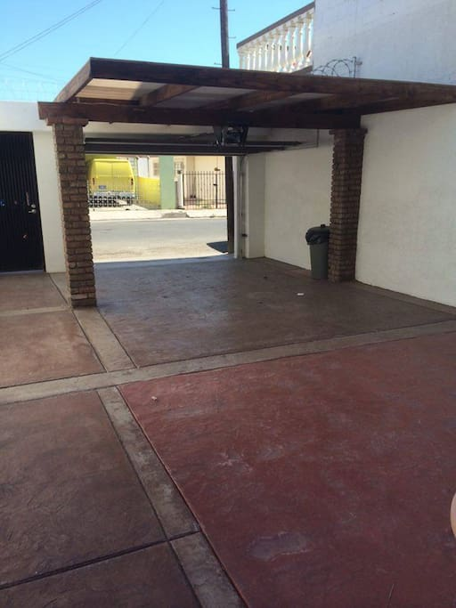 Entrance Garage with space for 2 vehicles and electric door