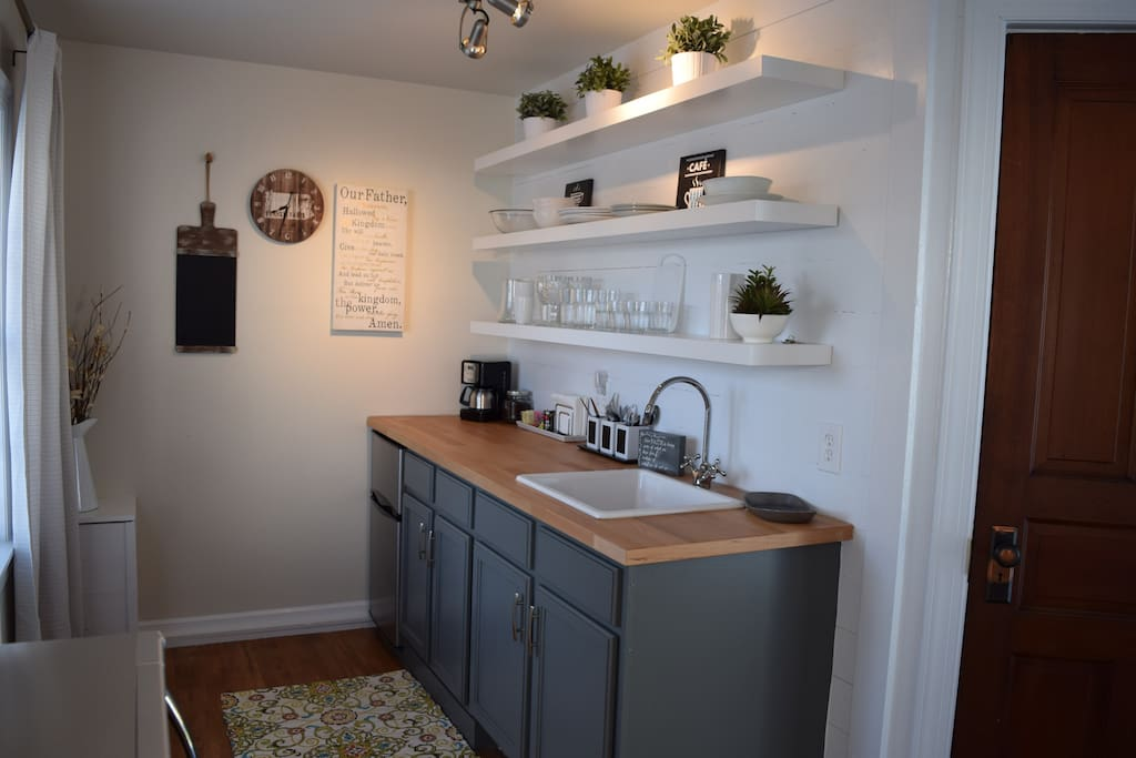 Kitchenette featuring a mini fridge and microwave