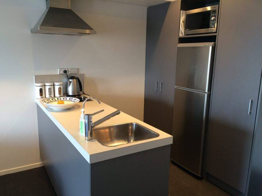 The modern kitchen has dishwasher, kettle, toaster, microave, fridge/freezer & complimentary tea/coffee/sugar. We provide a bottle of milk on arrival :)