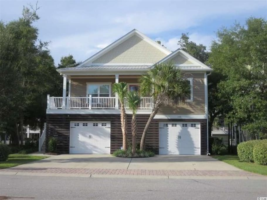 Lowcountry style raised ''cottage'' located steps away from our inlet (river), walking & bicycle greenway.