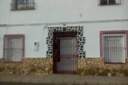 Habitación con dos camas - House