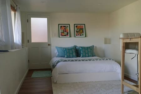 This well-lit basement suite will be your home away from home.   Mini frige, microwave, and electric kettle provided.  Mexican restaurant and coffee shop are a short walk down the hill.