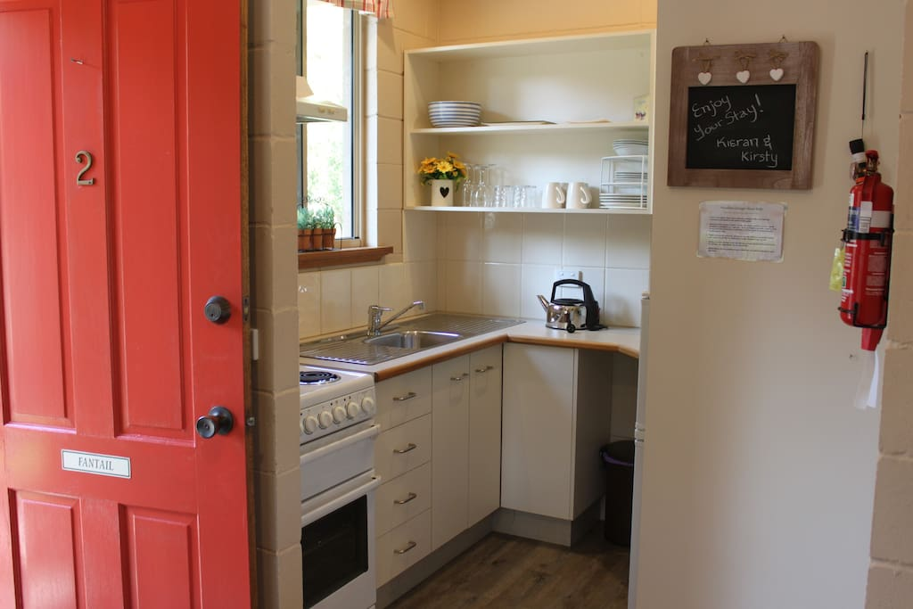 Fully equipped kitchen with full size fridge, oven, cook top & microwave