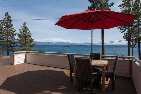 Perched above North Lake Blvd, this stately home boasts an amazing view of Lake Tahoe from across the shores in Tahoe Vista.