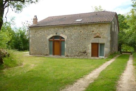 Grange en pierre à Floressas - Huis