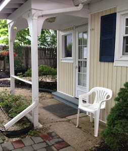Welcome to Spring Lake, a step back in time.  Our little cottage is located just one block from our beautiful beach.  The 2 mile non commercial boardwalk is a wonderful place to stroll, jog, run, and walk.  The spring fed lake is one half block away.
