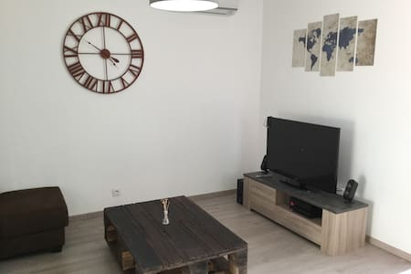 Agréable petit appartement - Wohnung
