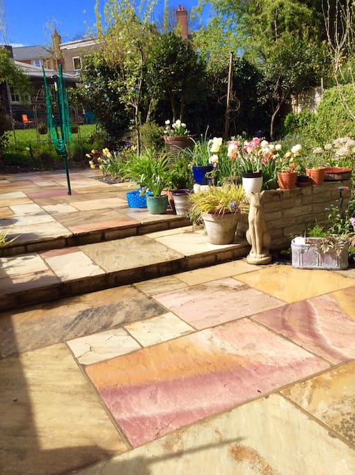 The back garden sandstone patio, with table tennis table