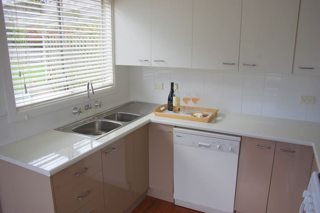 Modern well equipped kitchen with Miele dishwasher