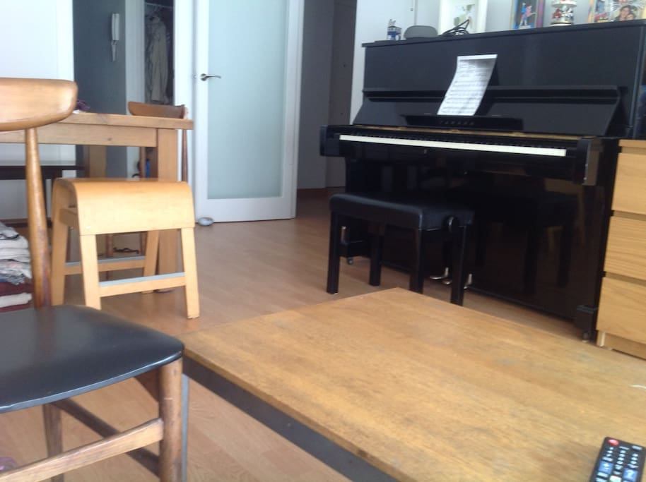 The flat has a piano you can enjoy if you know how to play.