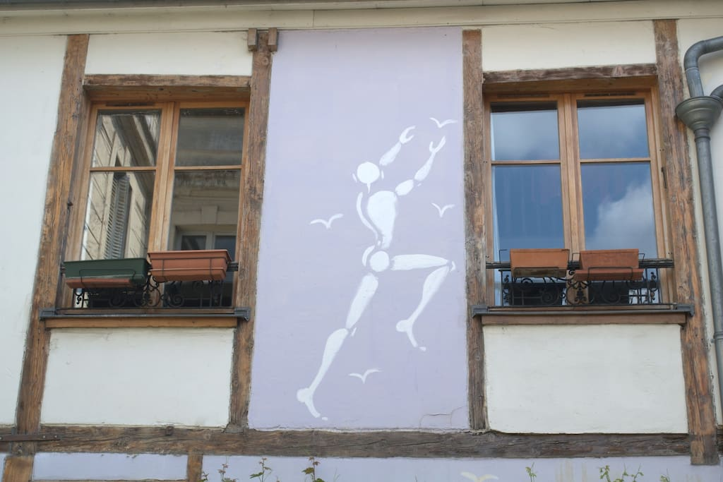 """The neighbour house features Jérôme Mesnager wall painting of """"l'homme blanc"""""""