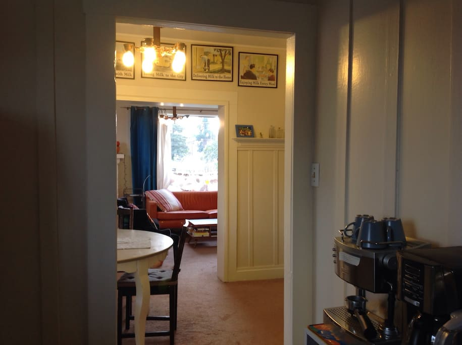 Here's a view from the kitchen as you make your morning coffee or tea, looking through the dining room into the living room where you can sit on the famous orange leather couch and watch the sun rise (or watch cable TV)