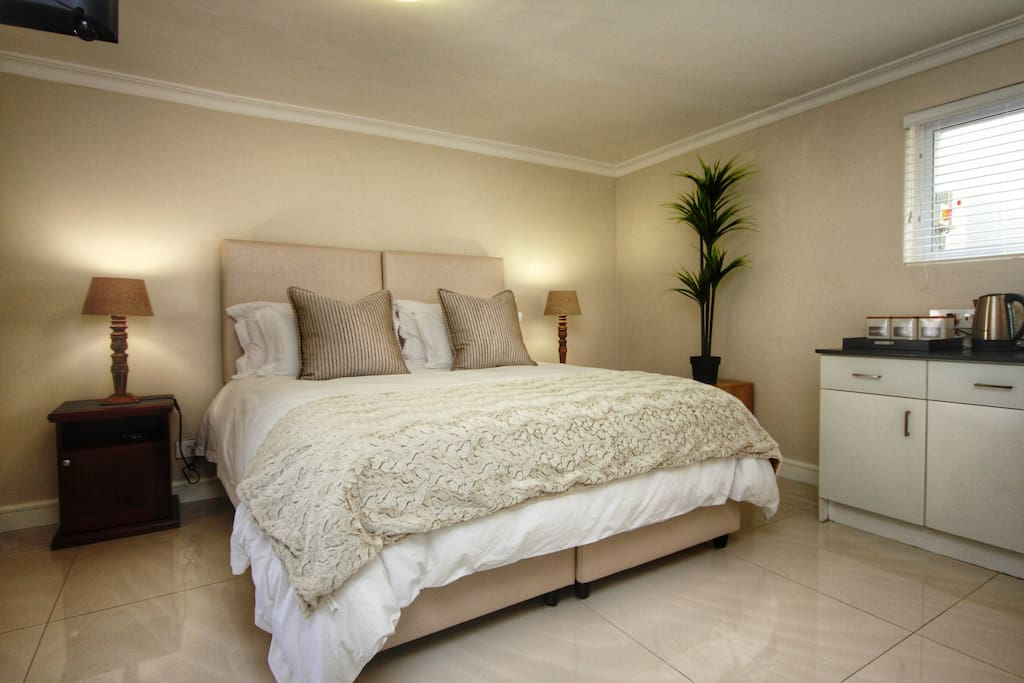 Comfortable king sized bed can be converted into two twin beds.