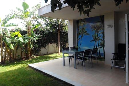 Apartamento con espectacular jardín frente al mar - Daimús - Pis