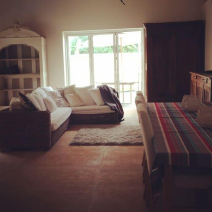 Open plan lounge with plasma TV (UK Sky television)