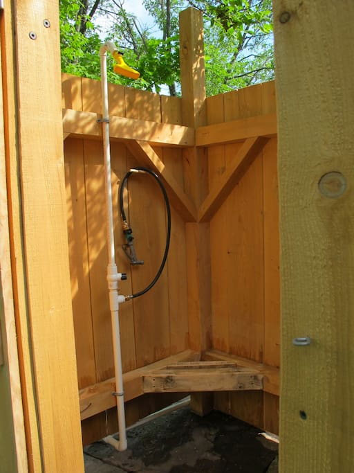 A country luxury - solar shower.   Privacy of an enclosed structure w/no roof.  You can look to the sky and tree tops.  May-early Oct.