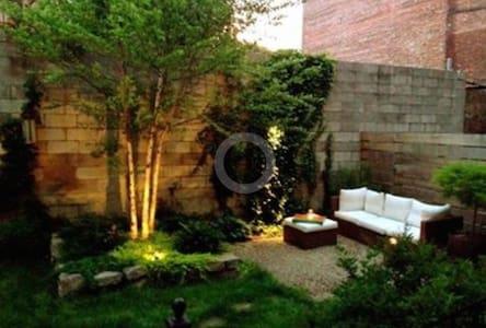 Stylish 1897 garden duplex oasis!