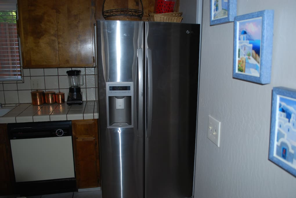 This shows the other side of our kitchen, with a large double door refrigerator.