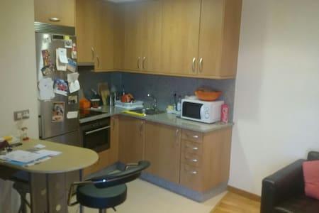 Apartamento de 1 dormitorio garaje - Apartemen