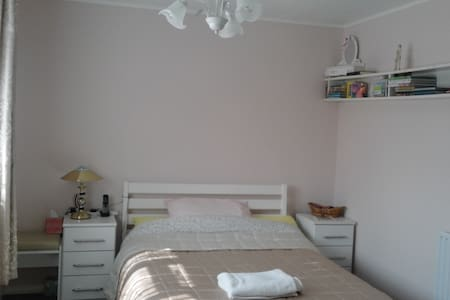 a  sunny spacious double bedroom - Casa