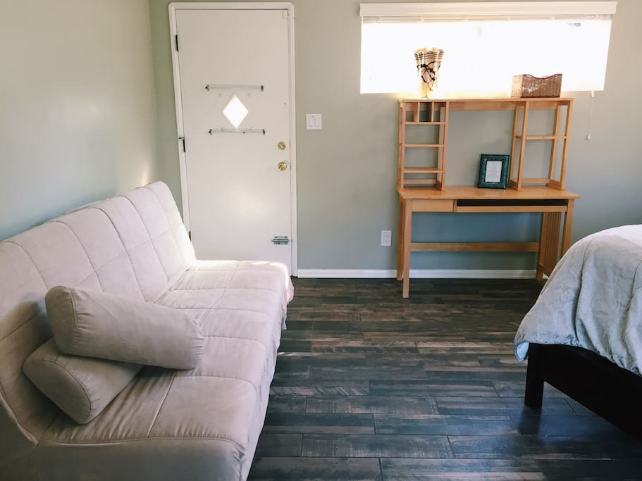 Suite includes a queen bed for two, a futon for two, a desk, two nightstands, and three closets. Suite also includes a private, full bathroom.