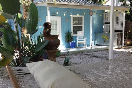 Retreat & relax in this Key west-style cottage or use as base camp for the MANY adventures nearby!  Detached from the main home & separated by a tranquil yard (fountain, hammock, firepit, grill & giant Jenga & cornhole set). Bicycles available, too!!