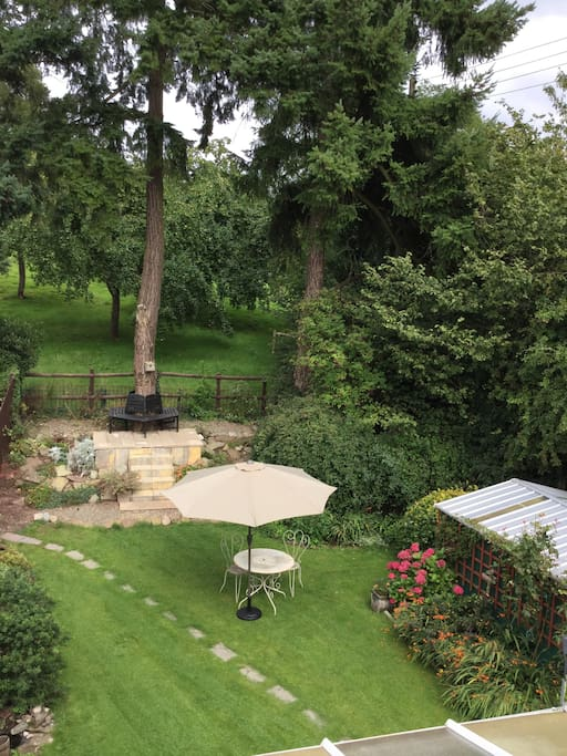 View of rear garden and orchard from guest bedroom.