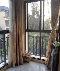西双版纳的万达国际度假区阳光通透的便宜公寓 - Xishuangbanna