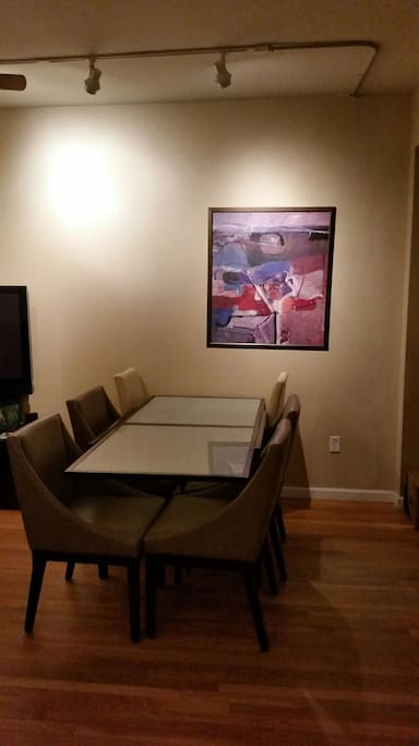 Dining area with a table that seats 8 comfortably (when pulled away from the wall). We have gorgeous track lighting with dimmers.