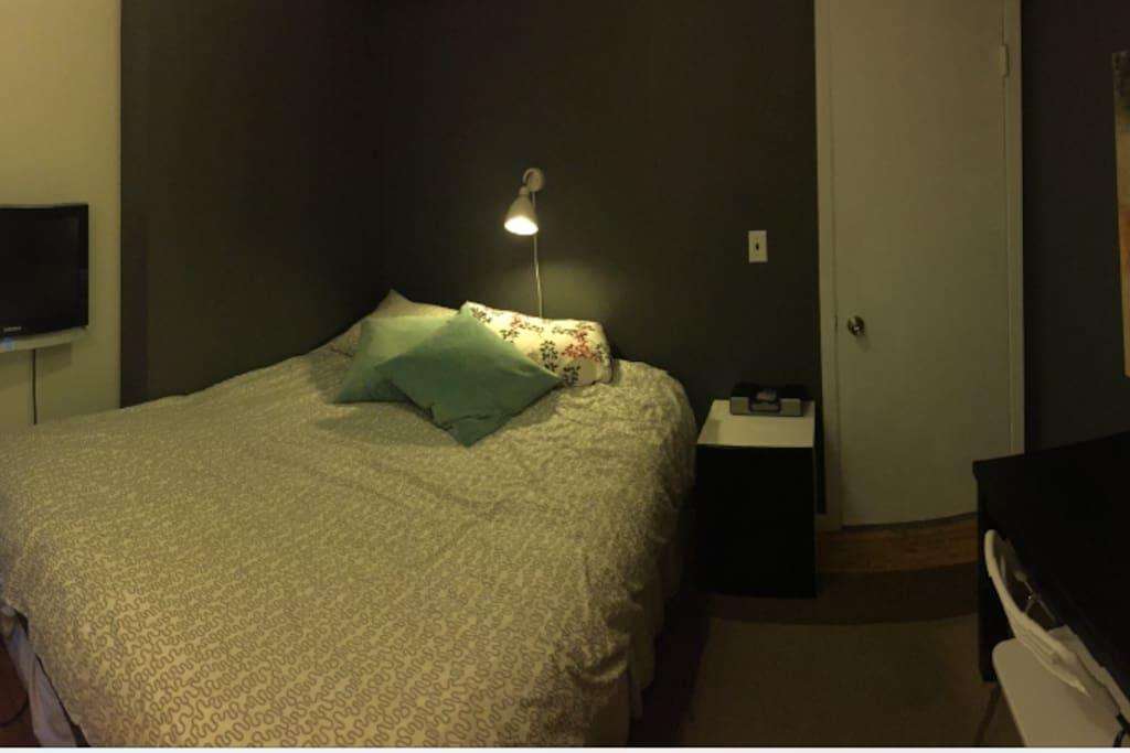 The Bedroom has a queen size bed, a desk and a closet for   your clothes. The TV swirls out from the wall.