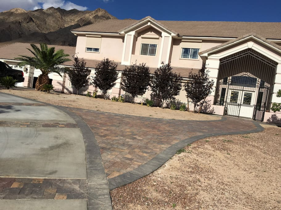 Paved walkway in cement driveway up to house