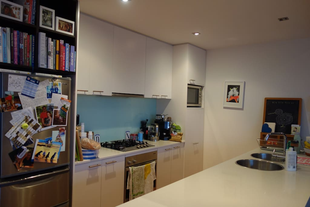Fully stocked kitchen with Miele appliances, double sink and breakfast bar