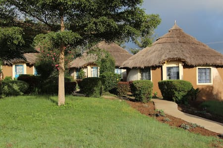 We offer six authentic African-style round bungalows, with their own kitchen and bathrooms.  Double beds and bunks, ideal for families, couples and groups of up to 30 people.  We have high level security, camping option for those with their own tent.