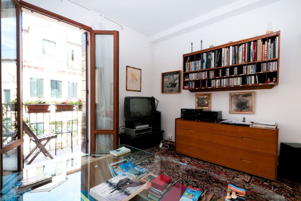 Stereo, TV, CD's,  Films and Art books  and balcony detail