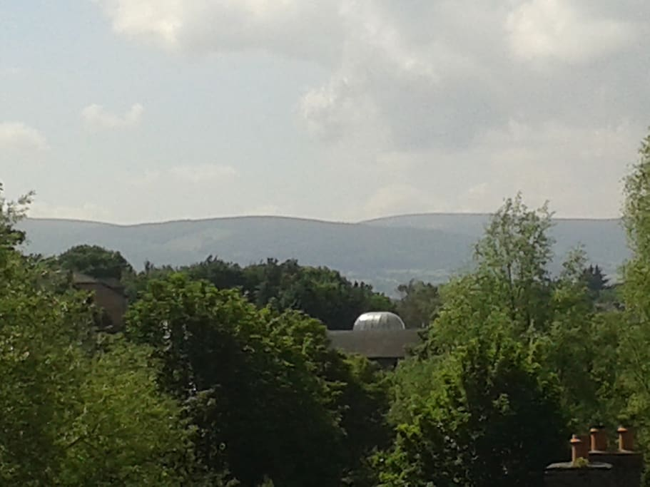 Wake up each morning to the *best views of any Dublin City apartment* towards the rolling Dublin mountains in the hazy sunshine