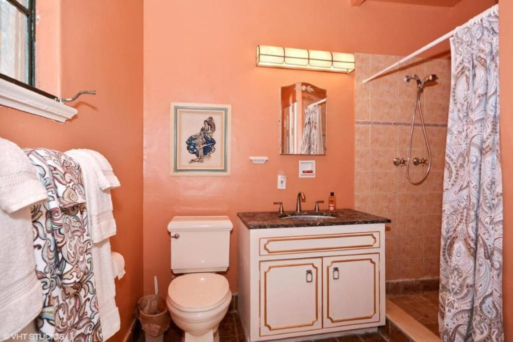 Master bedroom has cable TV, king-sized bed, doors opening to veranda, lovely furnishings.