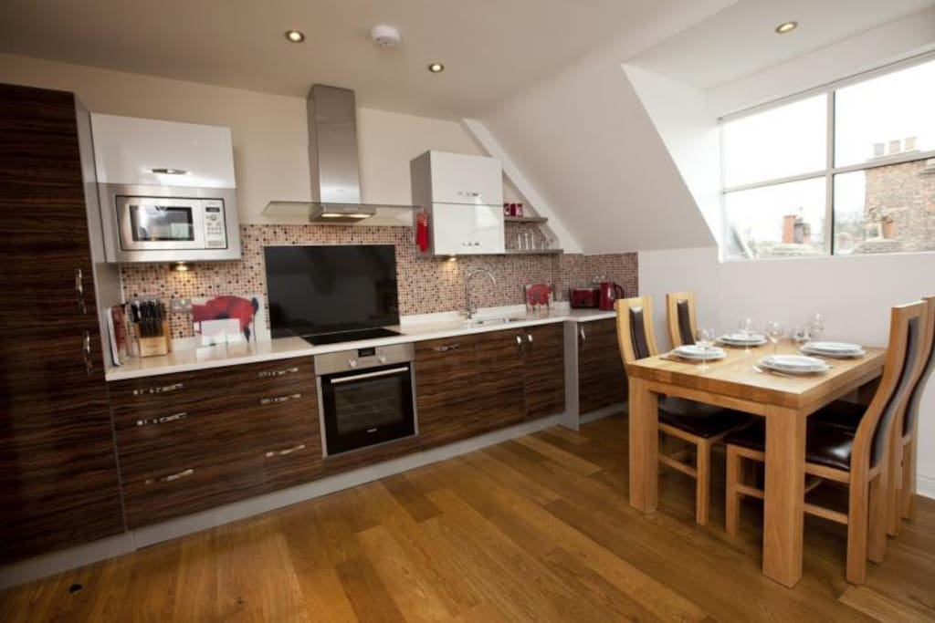 The kitchen area includes fridge-freezer, dishwasher, oven, hob, microwave and washer/dryer