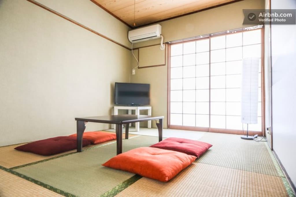 First bedroom is a traditional Japanese tatami room. Table folds away to make space for traditional Japanese futons.