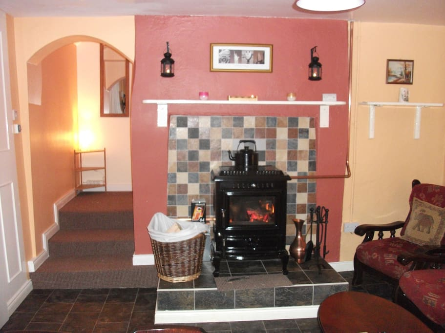 Lounge with log burning stove and access to second bedroom