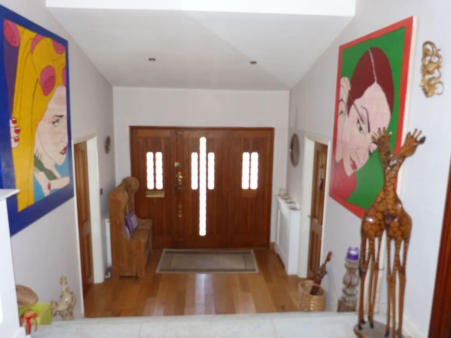 The hallway looking down to the front door.