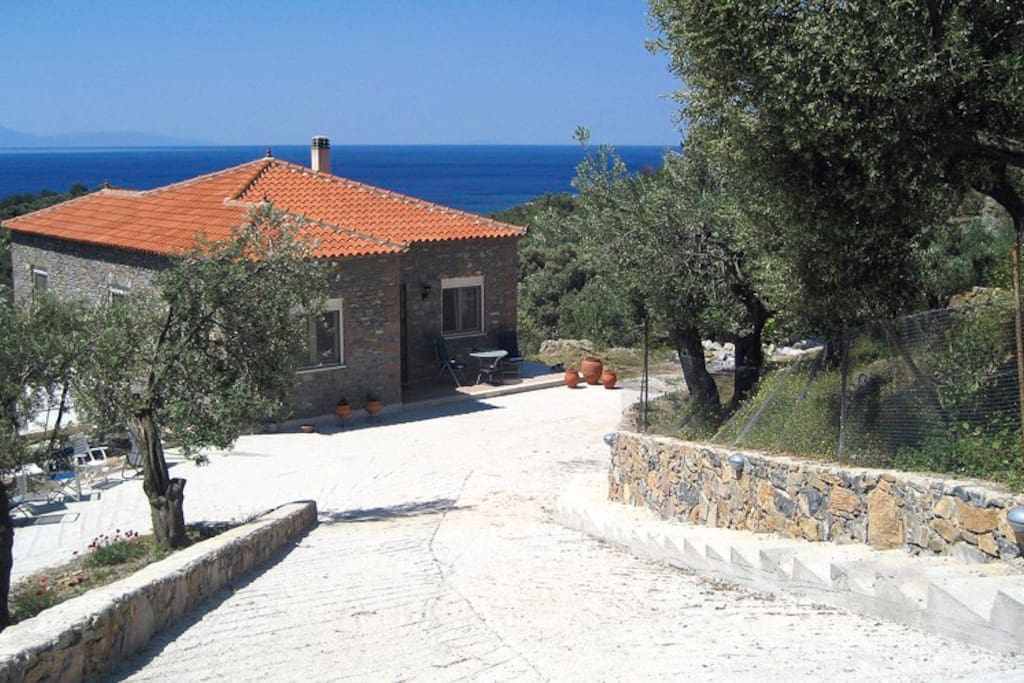 The driveway with the Aegean Sea behind the house