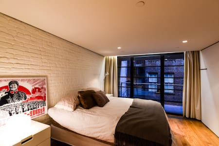 Bedroom in a beautifully renovated, modern SoHo loft apartment. Private bedroom and bathroom. Modern chefs kitchen, laundry, spacious living and dining area. Walk to the Hudson River, SoHo shops and restaurants, the West Village and Tribeca.