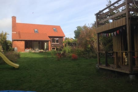 spacious and elegant house for one or two families. Fantastic garden, grill, fireplace, and huge playhouse. only 20 minutes from Copenhagen Center, and close to public transportation. Shops, as well as BIG shopping center 5 min. away.