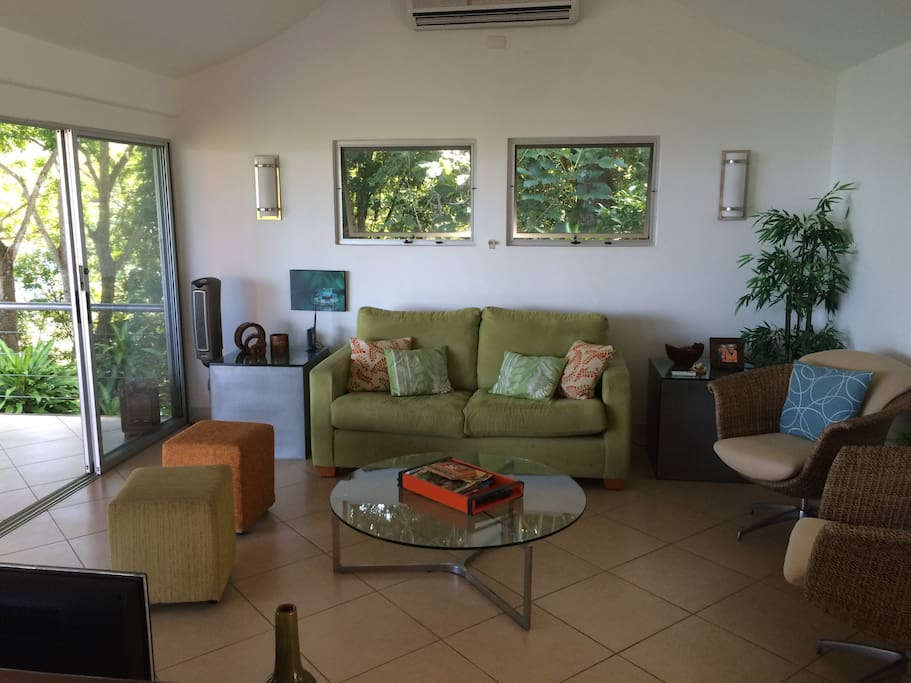 As you enter, the living room is on your right...