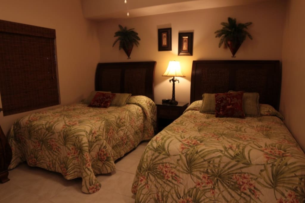 The guest bedroom offers two queen size beds for additional sleeping pleasure.