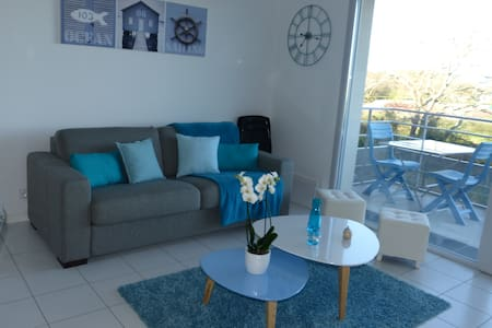 Bel appartement neuf dans résidence calme - WIFI - Apartment