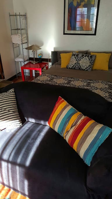 Queen size Bed. Colorful pillows. Relax.