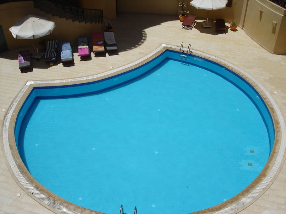 Larger of the 2 swimming pools, both have sunbeds and parasols