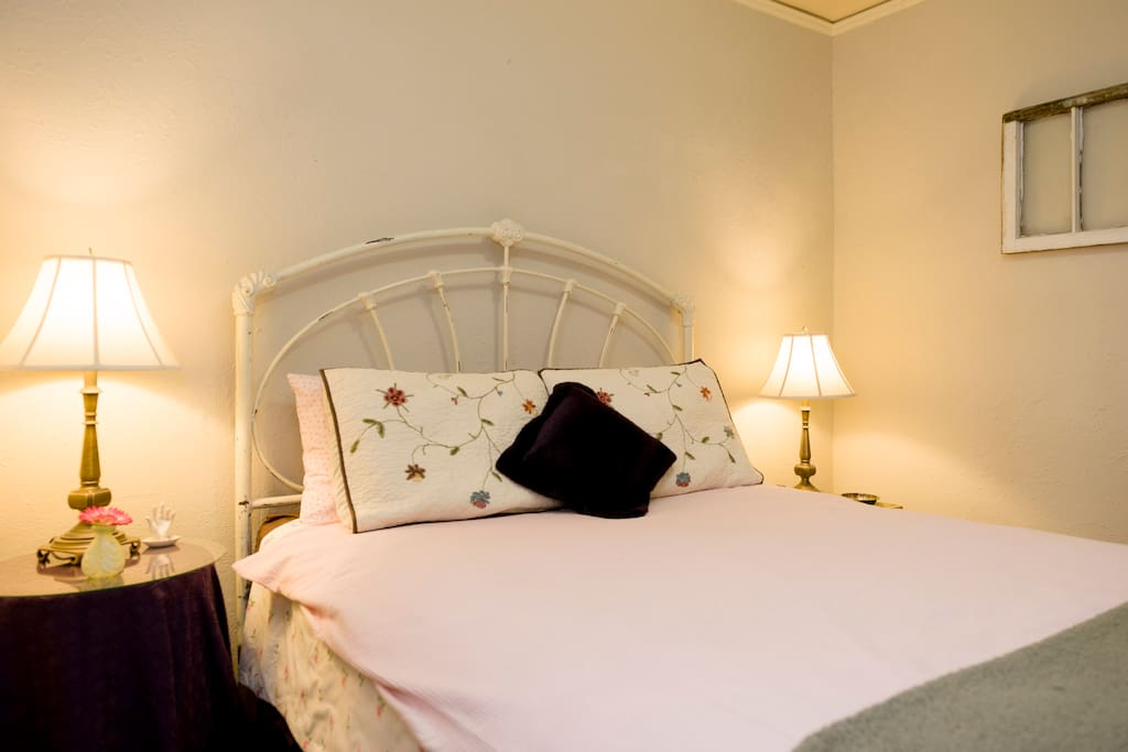 Antique bed frame, Queen mattress and box spring have that added layer of cover protection. Pillows have Allerease covers.