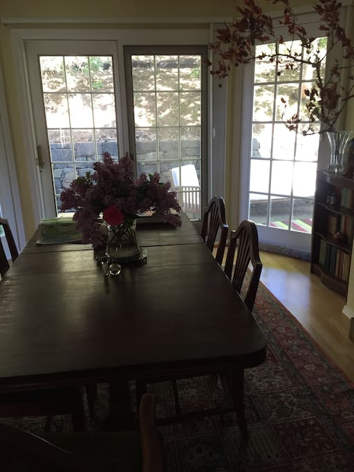 Formal dining room with French doors onto back patio